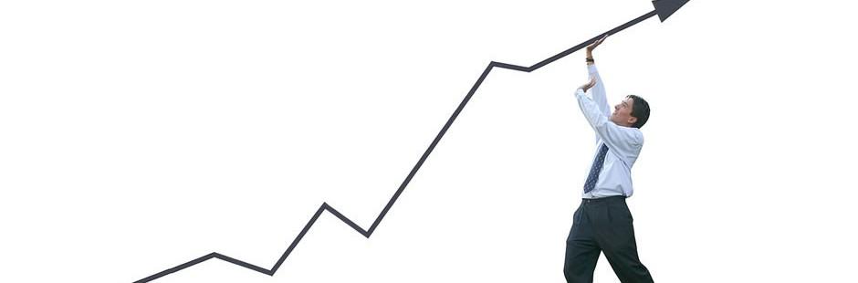 bigstock_Business_Man_Pushing_Graph_-__152309